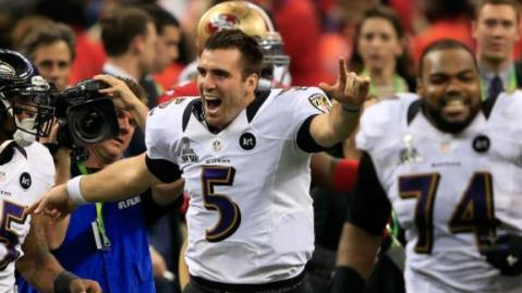 Flacco runs onto the field to celebrate.